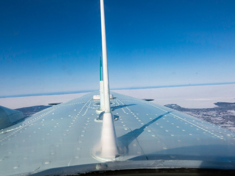 The view backwards along the top of a DC3, mid-flight.