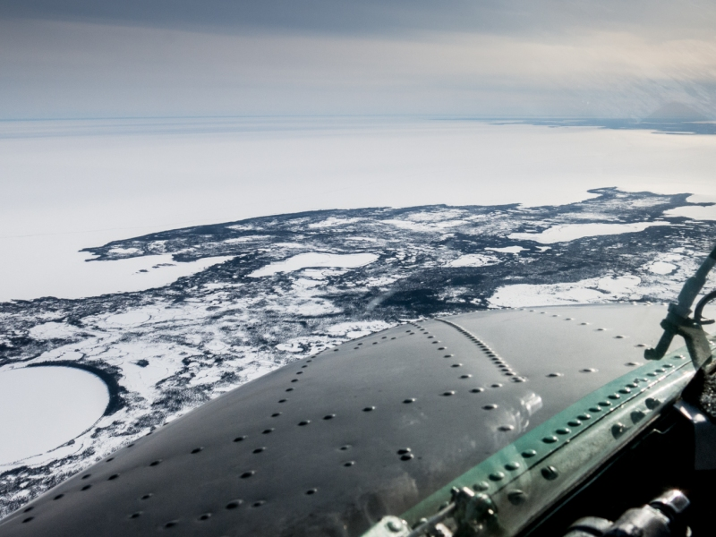The view from the cockpit of a DC3, heading south to Hay River over the vast, frozen Great Slave Lake.